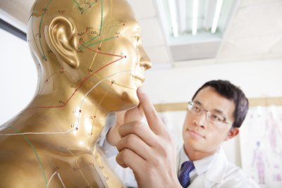 Doctor checking the acupuncture points